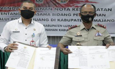 Penandatanganan nota kerjasama bidang pertanahan melalui Pola Tri Juang di Kabupaten Lumajang.